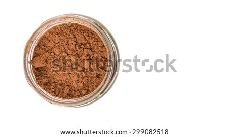 Brown pure cocoa powder in a mason jar over white background - stock photo
