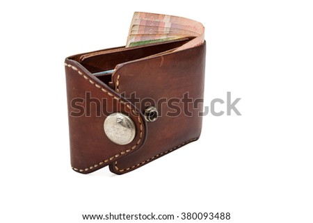 Brown purse with moneys (Bath) isolated on white background - stock photo