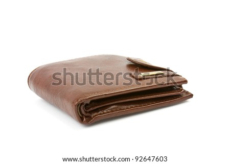 brown purse with the big pack of dollars - stock photo
