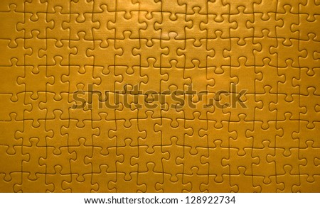 Brown puzzle texture - stock photo