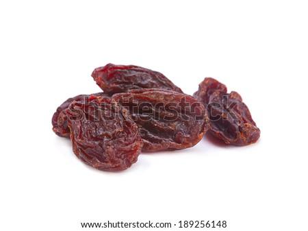 Brown raisin closeup isolated on white - stock photo