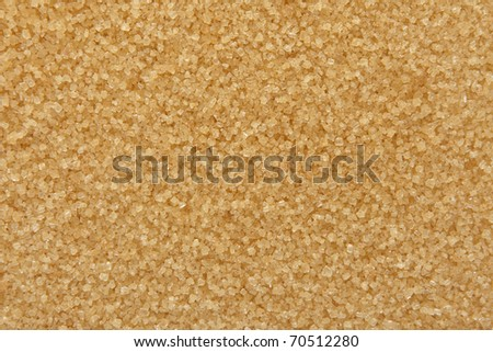 Brown, raw sugar background - stock photo