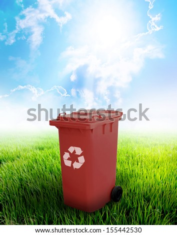 Brown Recycle Bin With Landscape Background.