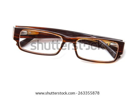Brown retro spectacles isolated on a white studio background. - stock photo