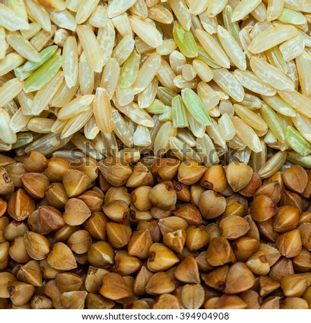 brown rice and buckwheat background close up - stock photo
