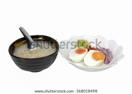 Brown rice gruel and salted egg, Chinese food style - stock photo