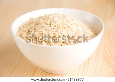 brown rice in ceramic bowl - stock photo