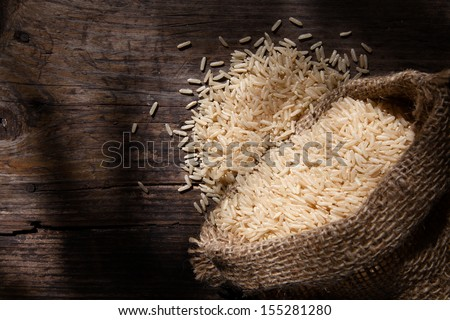 Brown rice in sack - stock photo