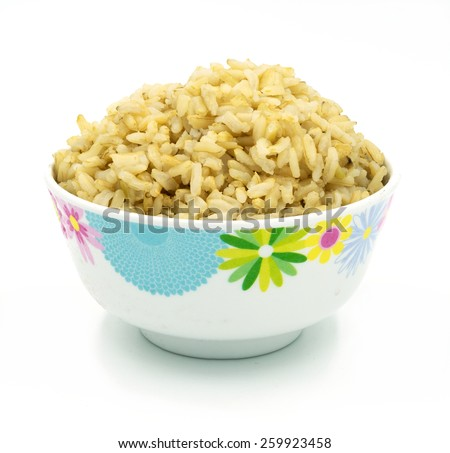 brown rice on white - stock photo