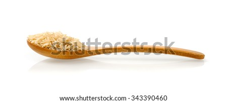 brown rice on wooden spoon - stock photo