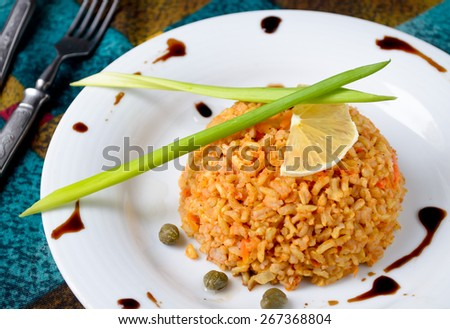 brown rice with capers, lemon, chive and balsamic vinegar - stock photo