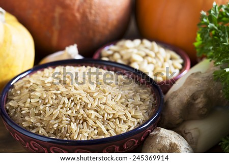 Brown rice with other ingredeints, healthy eating still life - stock photo