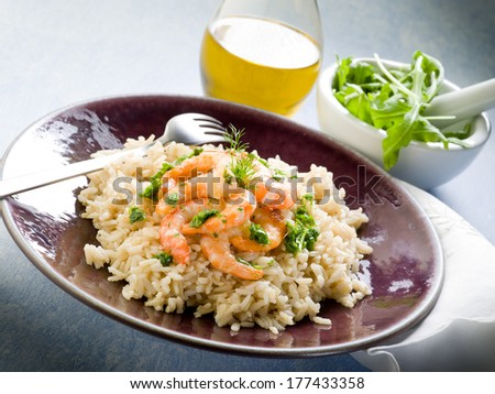 brown rice with shrimp and arugula pesto - stock photo