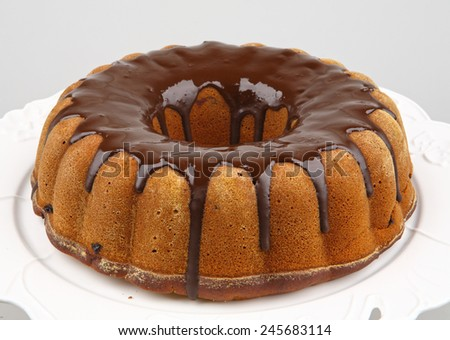 brown ring cake with chocolate frosting - stock photo