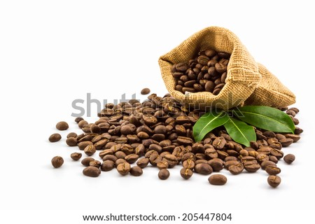 Brown roasted coffee beans in a canvas sack on white background. - stock photo