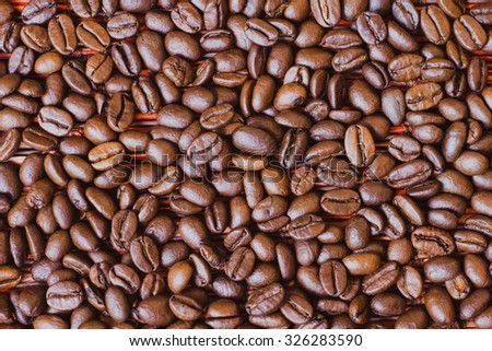 Brown roasted coffee beans, seed on red background. Espresso dark, aroma, black caffeine drink. Closeup isolated energy mocha, cappuccino ingredient.  - stock photo