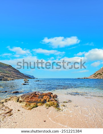 brown rock in Porticciolo beach, Sardinia - stock photo