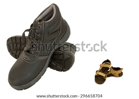 Brown safety shoe and slippers separated and isolated on white - stock photo