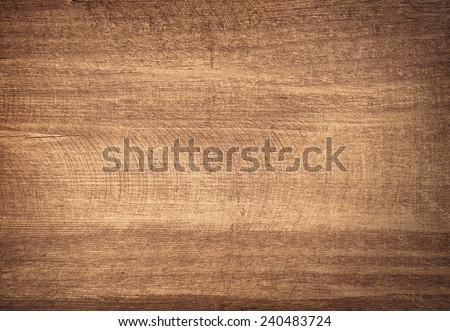 Brown scratched wooden cutting board. - stock photo