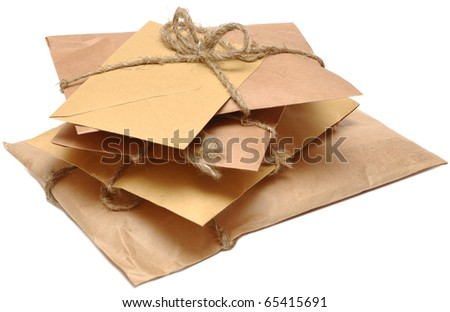 brown shipping parcel tied with twine on white