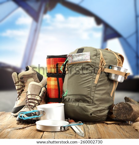 brown shoes brown backpack and tent  - stock photo