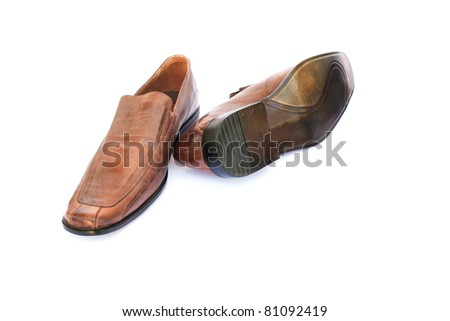 Brown shoes isolated on white background. - stock photo