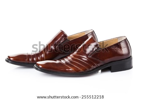 brown shoes pair.  Fashion concept with male shoes on white - stock photo