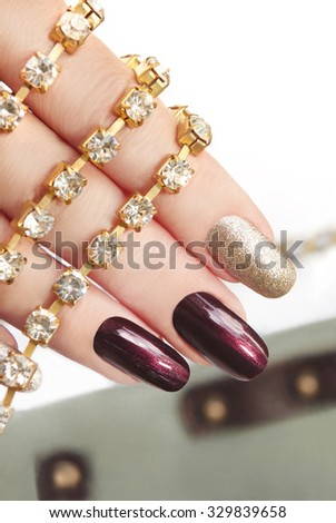 Brown silver manicure with rhinestones on the arm. - stock photo