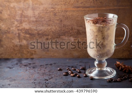 Brown smoothie of chocolate, banana and milk, coffee ice-cream cocktail on dark metal table with rusty brown background, copy space - stock photo