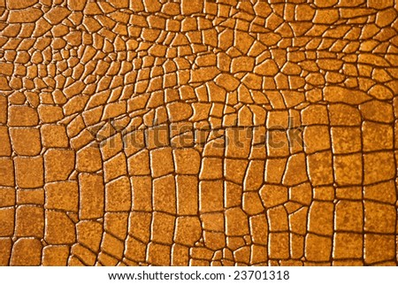 Brown snakeskin or crocodile texture for background - stock photo