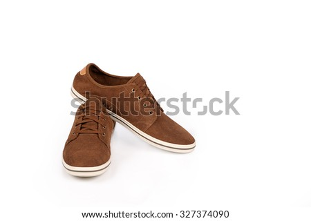 brown sneakers on a white background - stock photo