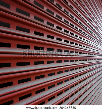 Brown steel Garage Security Gate in a diminishing perspective - stock photo