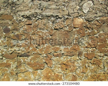Brown stone and concrete wall  - stock photo
