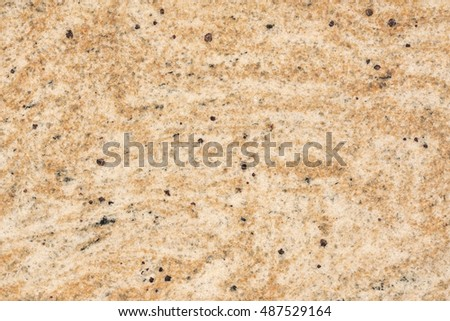 Brown stone with black spots, background, texture