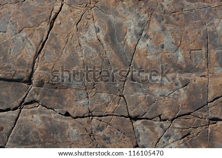 Brown stone with cracks on the surface - stock photo