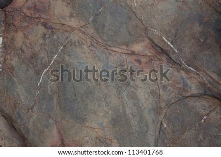 Brown stone with cracks on the surface roughness - stock photo