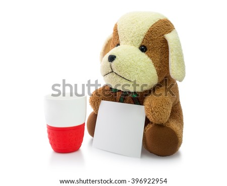 Brown stuffed dog with red mug and card isolated on white background. - stock photo