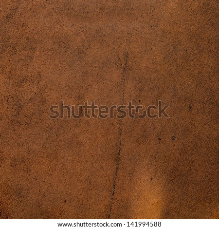 Brown suede closeup background. - stock photo