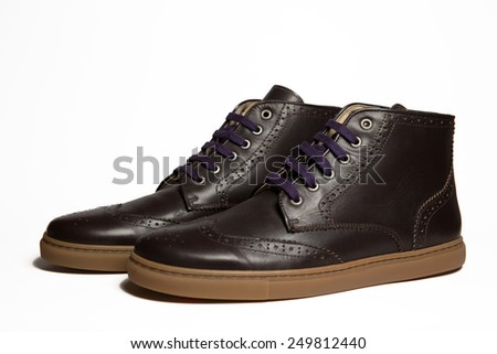 Brown suede leather sneakers on white background - stock photo
