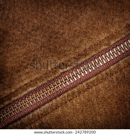 Brown suede texture and zipper background   - stock photo