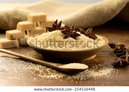 brown sugar and sugar cubes on a rustic table - stock photo