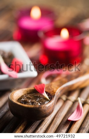 Brown sugar body polish on wooden spoon - stock photo