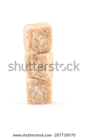 brown sugar cube isolated on a white background - stock photo
