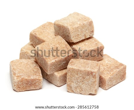 Brown sugar cube isolated on white background - stock photo