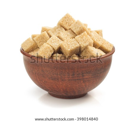 brown sugar cubes in bowl isolated on white background - stock photo
