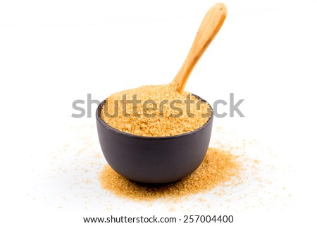 brown sugar in a bowl with wooden spoon  isolated on white - stock photo