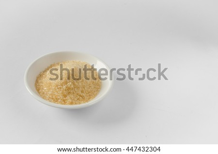 brown sugar in container on white background.