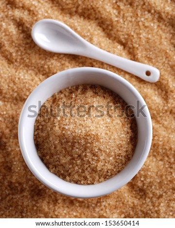 brown sugar in white bowl - stock photo