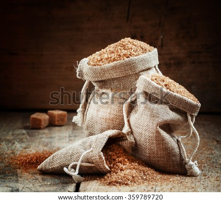 Brown sugar, packed in bags, selective focus - stock photo