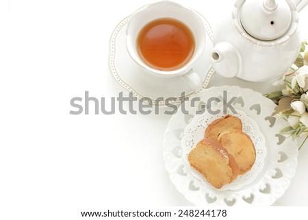 Brown sugar rusk and English tea - stock photo